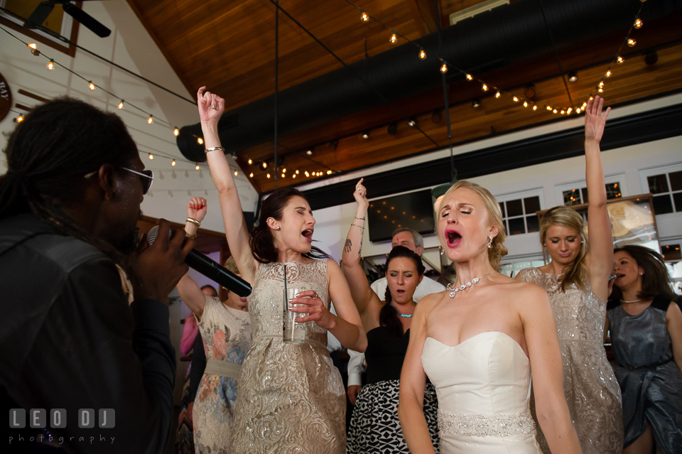 Bride, and guests dancing and singing along with Onyx band. Kent Island Maryland Chesapeake Bay Beach Club wedding photo, by wedding photographers of Leo Dj Photography. http://leodjphoto.com