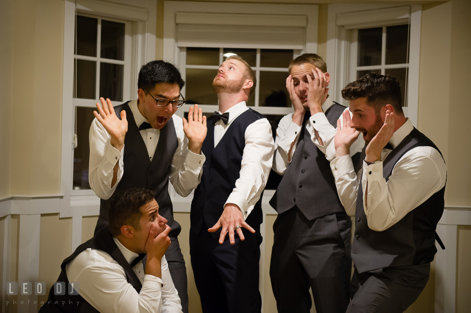 Groom showing off his wedding band to his Best Man and Groomsmen. Kent Island Maryland Chesapeake Bay Beach Club wedding photo, by wedding photographers of Leo Dj Photography. http://leodjphoto.com