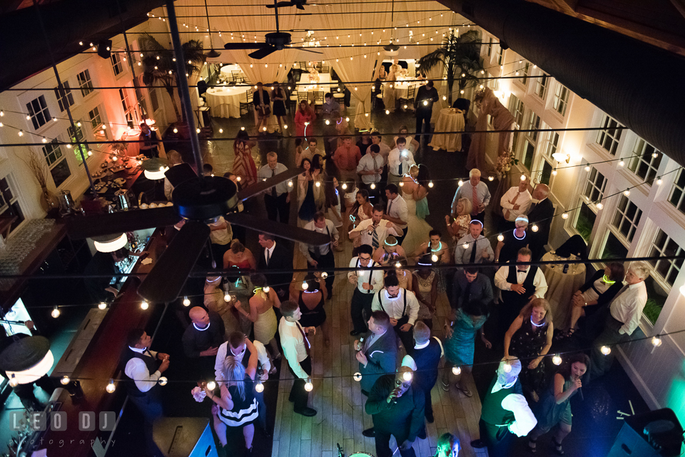 View from above of Bride, Groom, and guests dancing to the music from Onyx Band. Kent Island Maryland Chesapeake Bay Beach Club wedding photo, by wedding photographers of Leo Dj Photography. http://leodjphoto.com