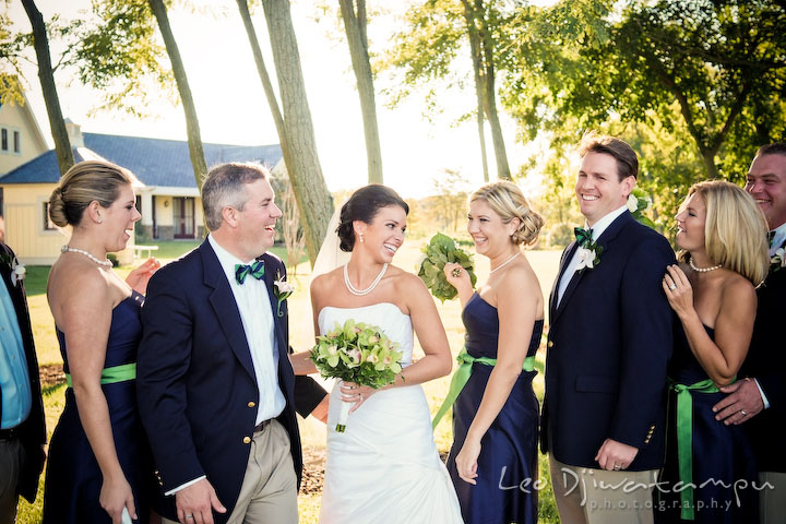 Bride, groom, maid of honor, best man, bridesmaids, and groomsmen laughing. Annapolis Kent Island Maryland Wedding Photography with live dance band at reception