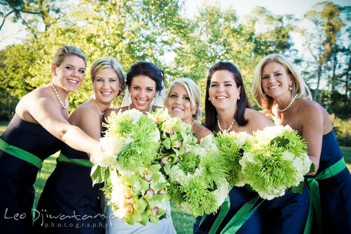 Bride, maid of honor, and bridesmaids showing their bouquet. Annapolis Kent Island Maryland Wedding Photography with live dance band at reception