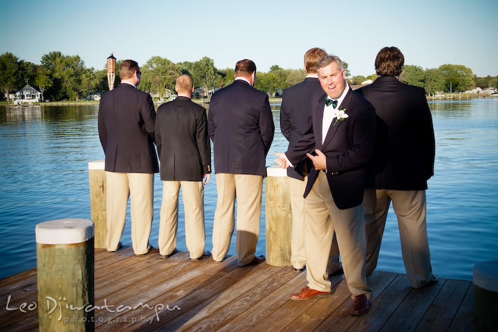 Groom, best man, and groomsmen doing funny pose. Annapolis Kent Island Maryland Wedding Photography with live dance band at reception