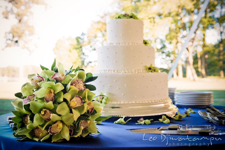 Wedding cake and the bride's orchid flower bouquet. Annapolis Kent Island Maryland Wedding Photography with live dance band at reception