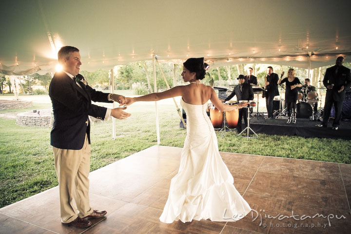Bride and groom's first dance on the dance floor with the live band in the background. Annapolis Kent Island Maryland Wedding Photography with live dance band at reception