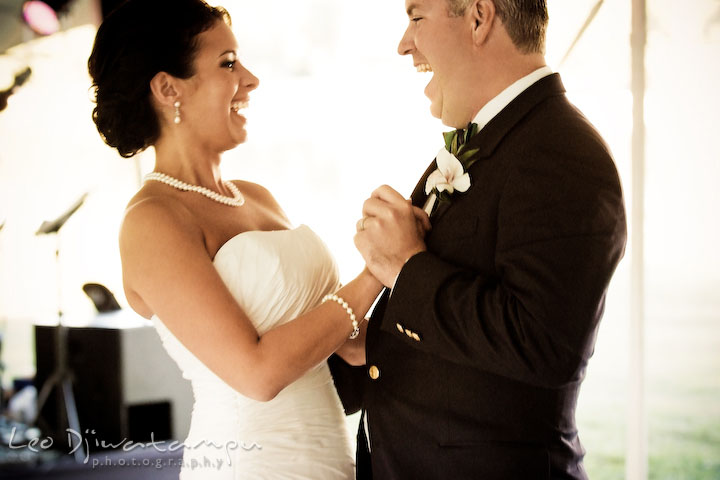 Bride and groom dancing at first dance and laughing together. Annapolis Kent Island Maryland Wedding Photography with live dance band at reception