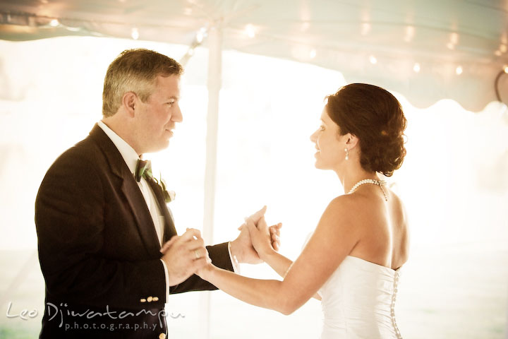 Bride ang groom holding hands and looking at each other. Annapolis Kent Island Maryland Wedding Photography with live dance band at reception