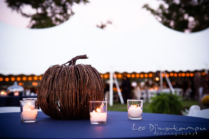 Wooden pumpkin and candles for table decorations. Annapolis Kent Island Maryland Wedding Photography with live dance band at reception