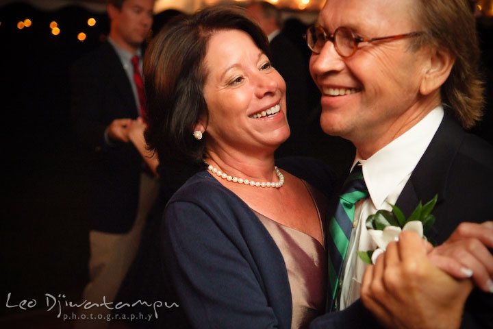 Bride's mother dancing with stepfather. Annapolis Kent Island Maryland Wedding Photography with live dance band at reception