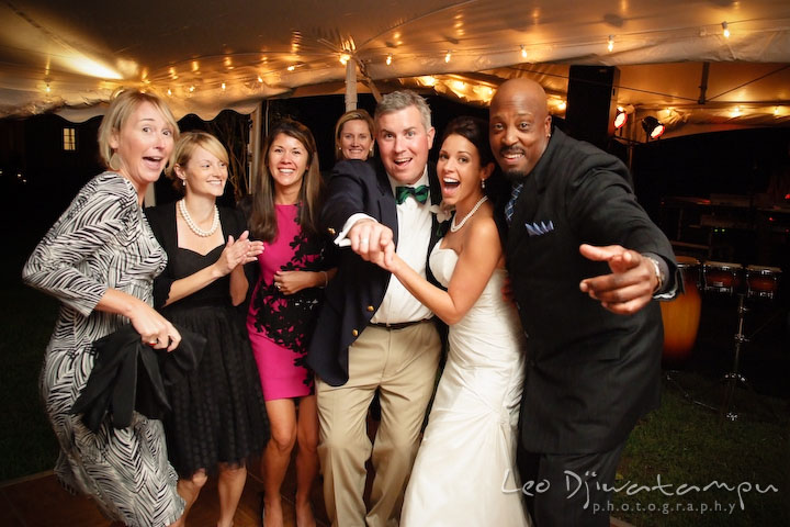 Bride, groom, guests, and wedding band singer posing and having fun. Annapolis Kent Island Maryland Wedding Photography with live dance band at reception