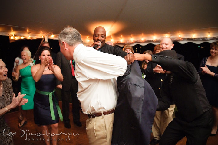 The groom taking off his jacket to get ready to dance. Annapolis Kent Island Maryland Wedding Photography with live dance band at reception