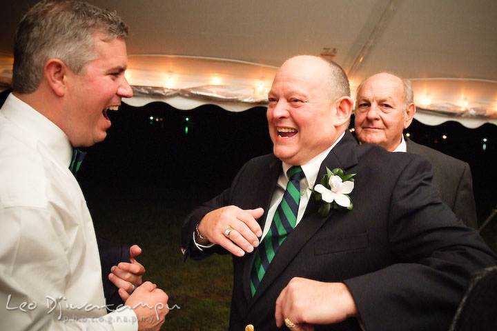 Groom and father of the bride dancing and laughing. Annapolis Kent Island Maryland Wedding Photography with live dance band at reception