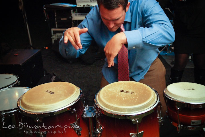 A guests played the band's percussion. Annapolis Kent Island Maryland Wedding Photography with live dance band at reception