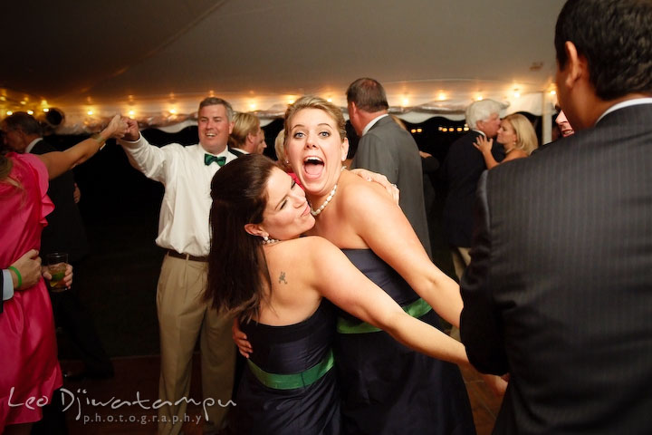 Bridesmaids dancing together, having fun. Annapolis Kent Island Maryland Wedding Photography with live dance band at reception