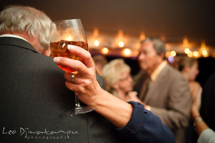 Guests dancing together, while holding a wine glass. Annapolis Kent Island Maryland Wedding Photography with live dance band at reception