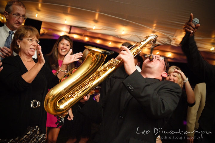 Band's saxophonist showing off his skills. Annapolis Kent Island Maryland Wedding Photography with live dance band at reception