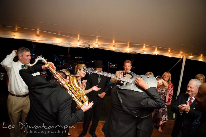 Onyx band members showing off their awesome guitar and saxophone skills. Annapolis Kent Island Maryland Wedding Photography with live dance band at reception