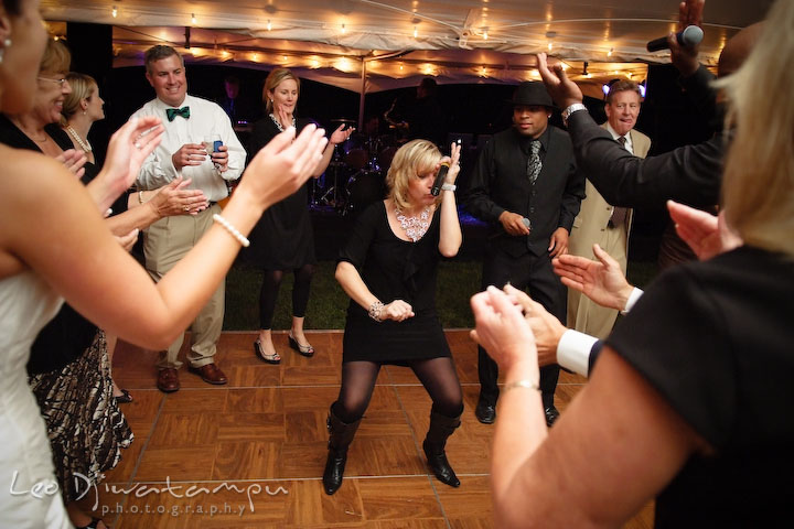 Onyx band female singer and MC entertaining guests. Annapolis Kent Island Maryland Wedding Photography with live dance band at reception