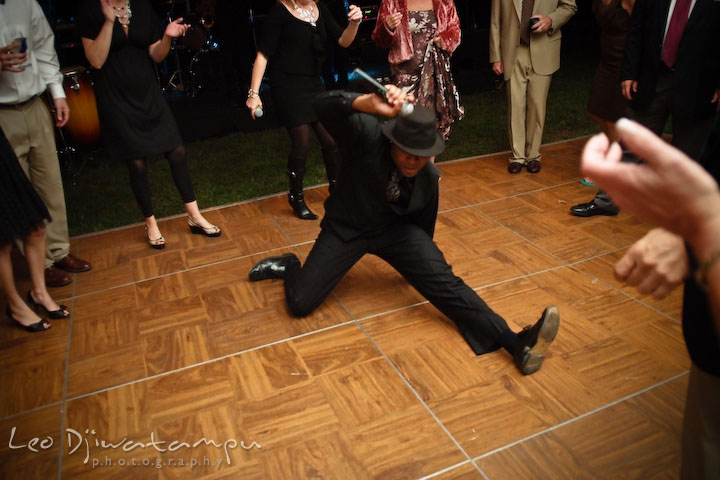 Onyx band's male singer doing a split on the dance floor. Annapolis Kent Island Maryland Wedding Photography with live dance band at reception