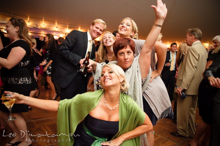 Bridesmaid, maid of honor and other guests doing wacky pose for the camera. Annapolis Kent Island Maryland Wedding Photography with live dance band at reception