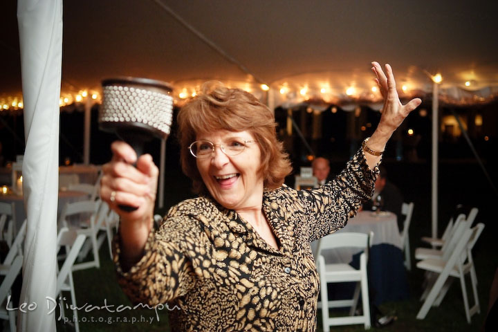 A guest playing maracas. Annapolis Kent Island Maryland Wedding Photography with live dance band at reception