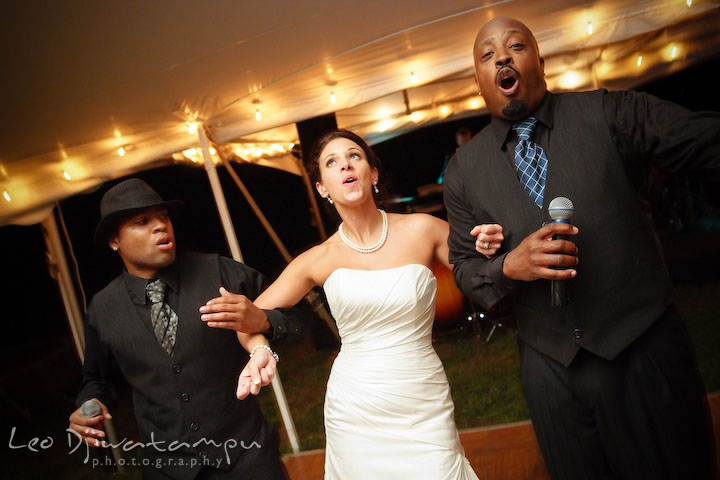 Bride dancing and singing together with the band singers. Annapolis Kent Island Maryland Wedding Photography with live dance band at reception