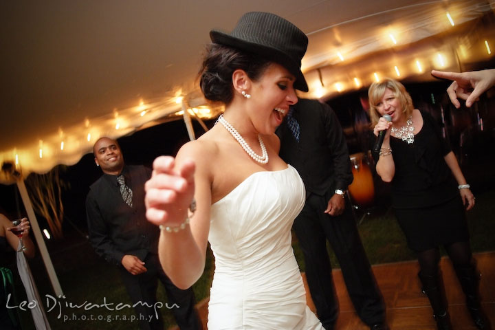Bride wearing a hat and dancing with the music. Annapolis Kent Island Maryland Wedding Photography with live dance band at reception
