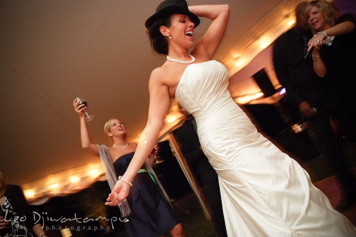 The bride having fun dancing. Annapolis Kent Island Maryland Wedding Photography with live dance band at reception
