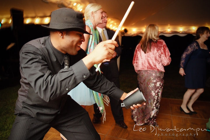 The band's vocalist playing cowbell. Annapolis Kent Island Maryland Wedding Photography with live dance band at reception