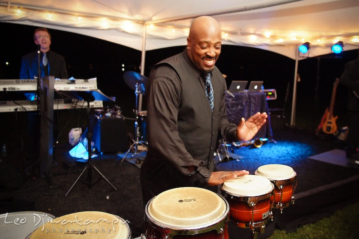 Band's vocalist playing congos. Annapolis Kent Island Maryland Wedding Photography with live dance band at reception