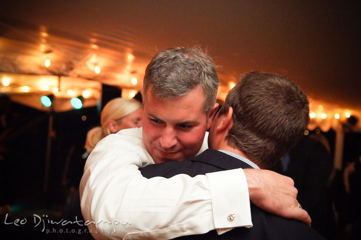 Groom hugging one of the guests. Annapolis Kent Island Maryland Wedding Photography with live dance band at reception