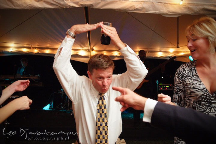 A guest doing a wacky dance pose. Annapolis Kent Island Maryland Wedding Photography with live dance band at reception