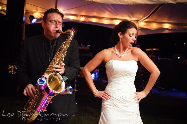 Saxophonist displaying lights and bride dancing. Annapolis Kent Island Maryland Wedding Photography with live dance band at reception