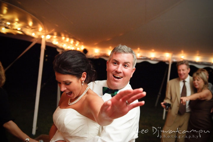 Bride and groom dancing together and having fun. Annapolis Kent Island Maryland Wedding Photography with live dance band at reception