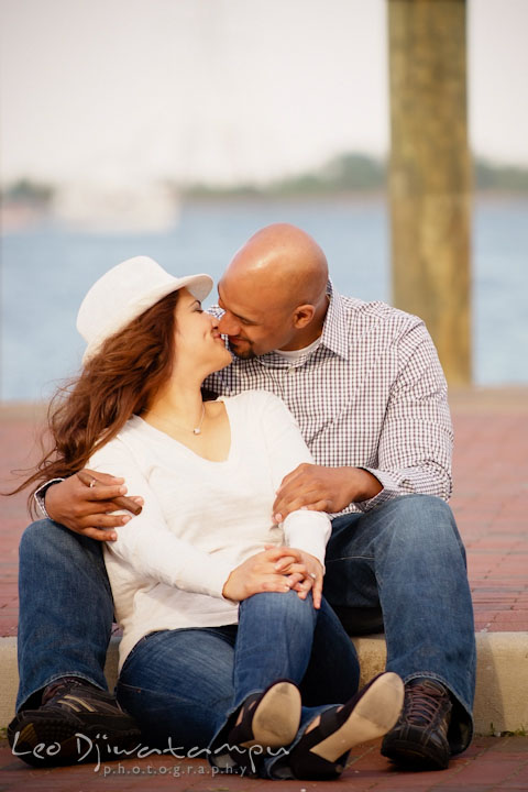 Engaged guy cuddling his fiancée by the pier. Annapolis Maryland USNA Pre-Wedding Engagement Photo Session by wedding photographer Leo Dj Photography