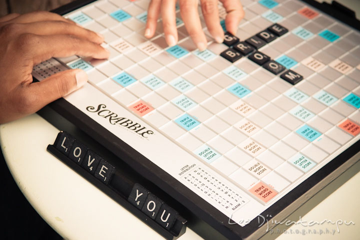 Spelling love you and bride groom on scrabble board. Annapolis Maryland USNA Pre-Wedding Engagement Photo Session by wedding photographer Leo Dj Photography