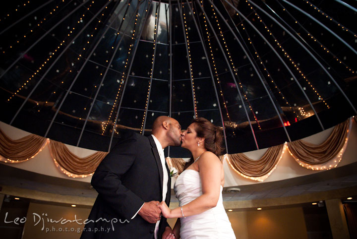 Bride groom kissing under the dome. The Grand Marquis, Old Bridge, New Jersey wedding photos by wedding photographers of Leo Dj Photography.