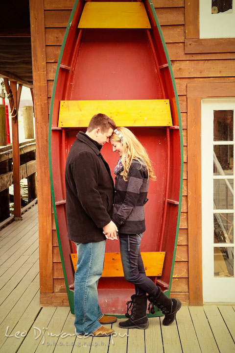 Fiancé and his fiancée holding hands, touching heads, by a boat. Old Town Alexandria Virgina Pre-wedding Engagement Photo Session Photographer, Leo Dj Photography