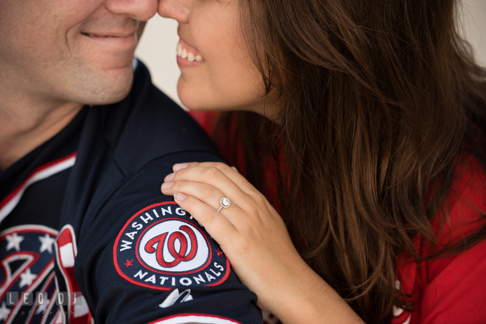 Engaged girl and her fiance with MLB Washington Nationals jersey and cap showing her beautiful diamond engagement ring. Leesburg Virginia pre-wedding engagement photo session at River Creek Club, by wedding photographers of Leo Dj Photography. http://leodjphoto.com
