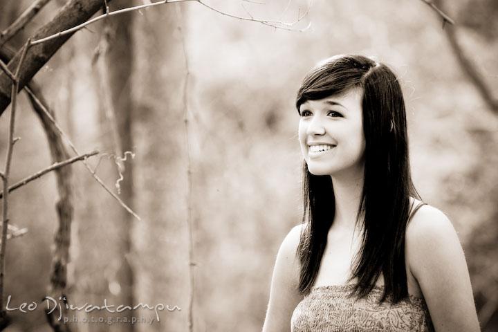 High school senior girl in woods smiling. Kent Island Annapolis High School Senior Portrait