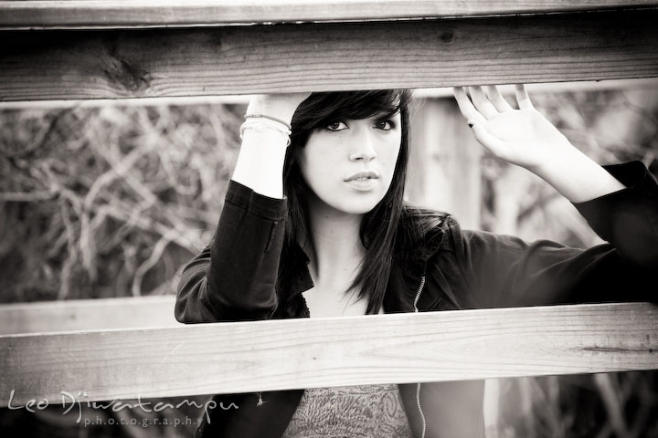 girl posing by wooden fence, black and white. Kent Island Annapolis High School Senior Portrait