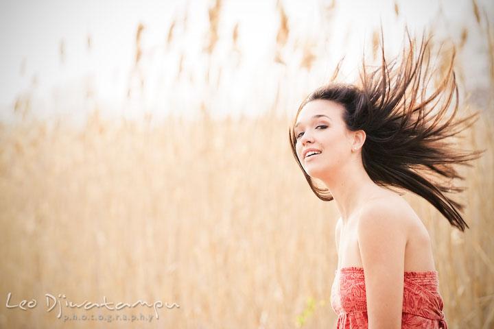 Girl swinging her hair up in the air. Kent Island Annapolis High School Senior Portrait