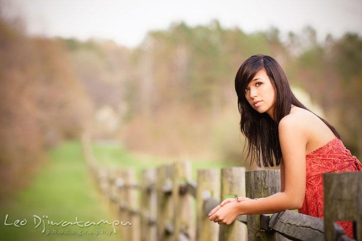 girl leaning on wooden fence. Kent Island Annapolis High School Senior Portrait