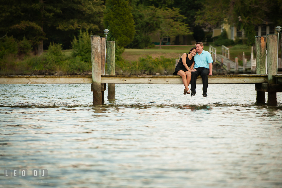 Engaged girl cuddled with her fiancé. Eastern Shore Maryland pre-wedding engagement photo session at Easton MD, by wedding photographers of Leo Dj Photography. http://leodjphoto.com