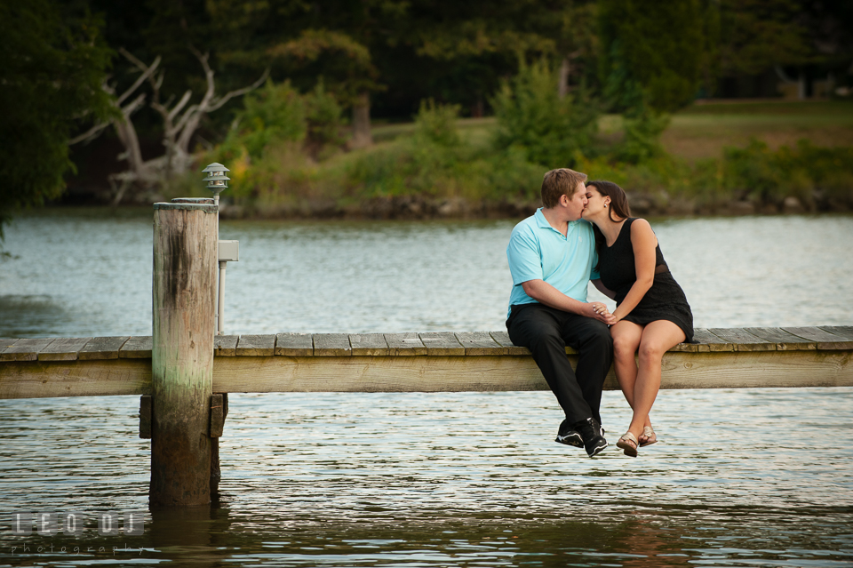 Engaged man kissing his fiancee at a dock. Eastern Shore Maryland pre-wedding engagement photo session at Easton MD, by wedding photographers of Leo Dj Photography. http://leodjphoto.com