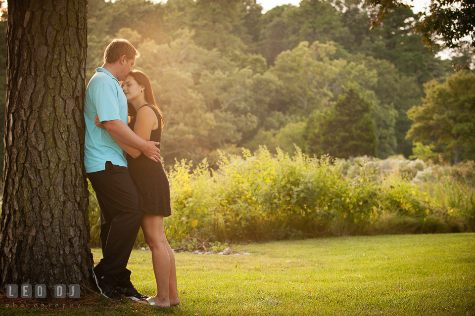 Engaged man kissed his fiancée's forehead in the garden. Eastern Shore Maryland pre-wedding engagement photo session at Easton MD, by wedding photographers of Leo Dj Photography. http://leodjphoto.com