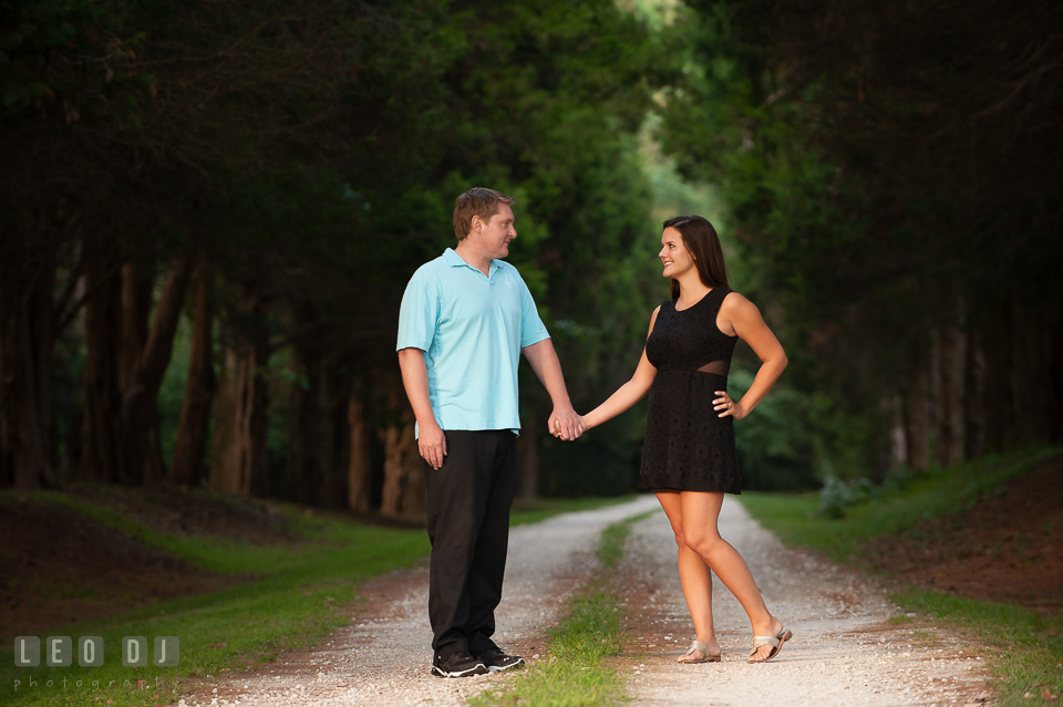 Engaged couple in the woods holding hands looking at each other. Eastern Shore Maryland pre-wedding engagement photo session at Easton MD, by wedding photographers of Leo Dj Photography. http://leodjphoto.com