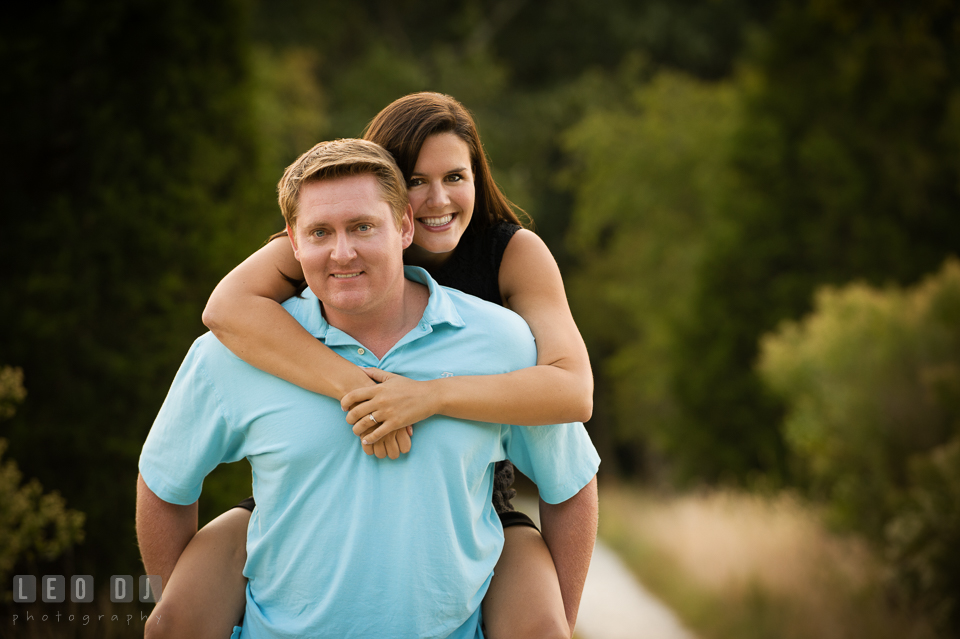 Engaged guy carrying his fiancee on his back. Eastern Shore Maryland pre-wedding engagement photo session at Easton MD, by wedding photographers of Leo Dj Photography. http://leodjphoto.com