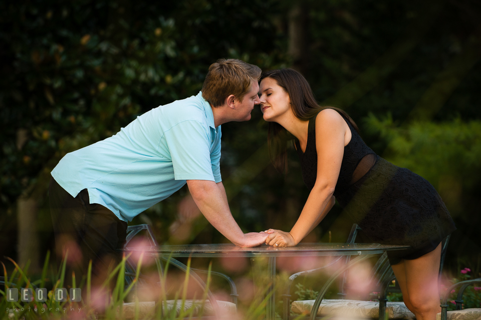 Engaged girl almost kissed her fiance in a flower garden. Eastern Shore Maryland pre-wedding engagement photo session at Easton MD, by wedding photographers of Leo Dj Photography. http://leodjphoto.com