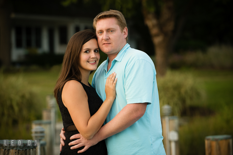 Engaged man holding tight his fiancée. Eastern Shore Maryland pre-wedding engagement photo session at Easton MD, by wedding photographers of Leo Dj Photography. http://leodjphoto.com