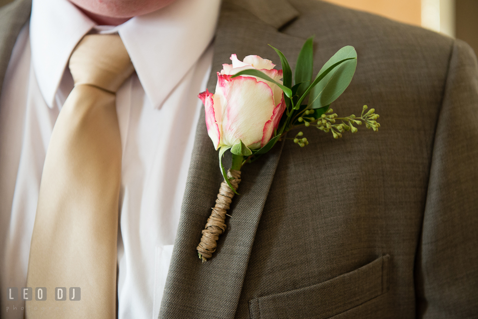 Pinned boutonniere on Groom's jacket. Hyatt Regency Chesapeake Bay wedding at Cambridge Maryland, by wedding photographers of Leo Dj Photography. http://leodjphoto.com